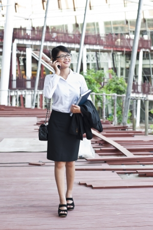Beautiful Asian business woman inspecting construction site  photo