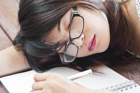 Beautiful Asian student woman tired and sleep  Stock Photo - 21356825