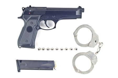 manacle: Pistol bullet magazine and handcuff isolated  Stock Photo