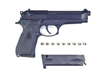 45 ammo: Pistol bullet and magazine isolated  Stock Photo