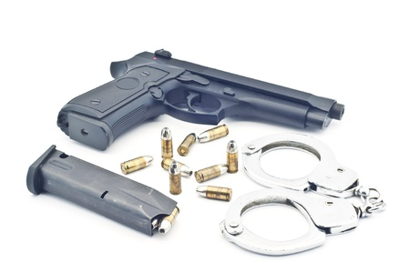 Pistol bullet magazine and handcuff isolated  Stock Photo