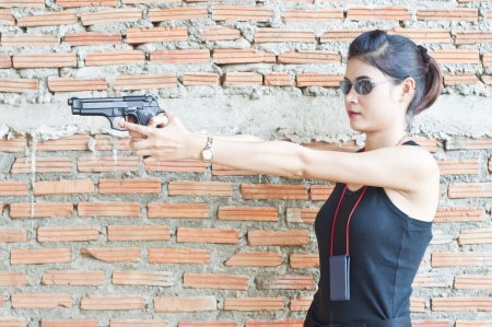 arresting: Beautiful Asian policewoman in action  Stock Photo