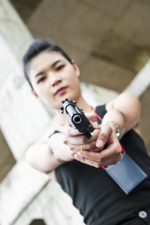 Beautiful Asian policewoman in action  photo