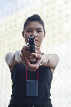 Beautiful Asian policewoman in action  Stock Photo