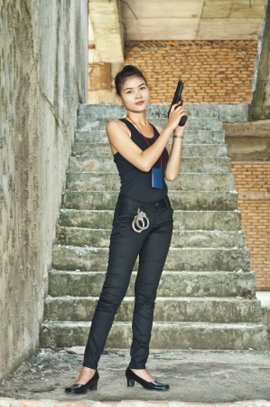 special agent: Beautiful Asian policewoman in action  Stock Photo