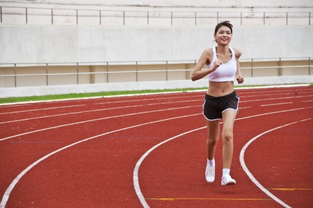 Asian sport girl exercising in public nation stadium  photo