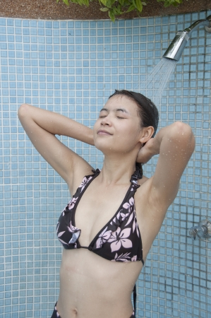Beautiful Asian woman take a shower  photo