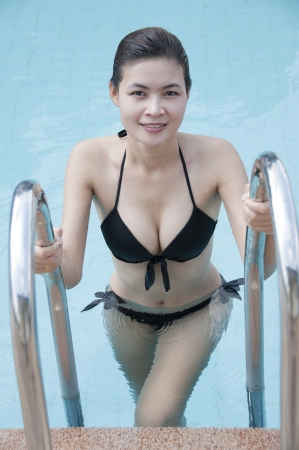 Beautiful Asian woman in swimming pool  Stock Photo