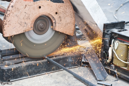 Worker cutting steel bars  photo