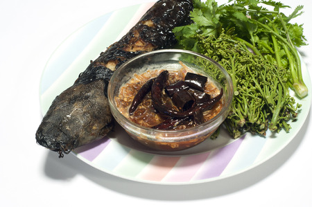 neem: Grilled catfish and tamarind sauce and neem