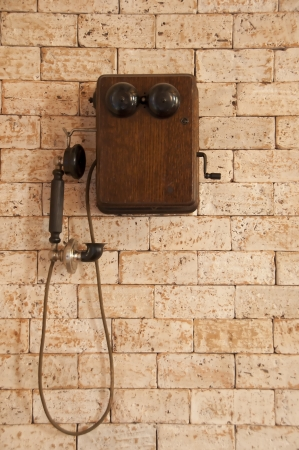 Antique telephone on brick wall  Stock Photo