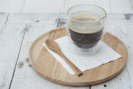 Cup of coffee on wooden tray