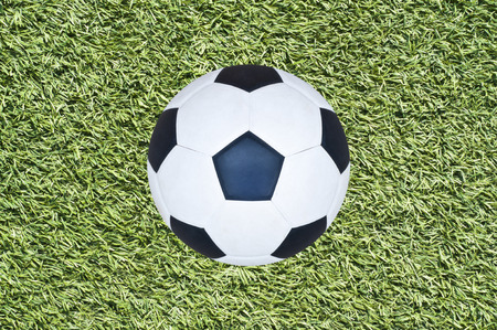 Soccer ball on grass field  photo