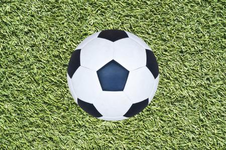 Soccer ball on grass field  photo