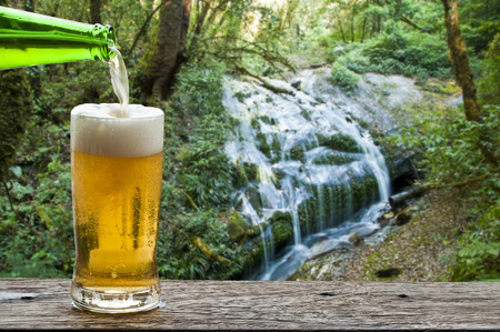Enjoy beer with waterfall landscape  photo