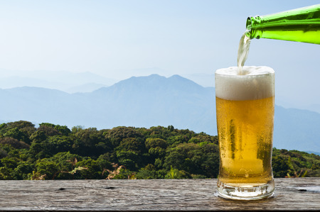 Enjoy beer with mountain landscape