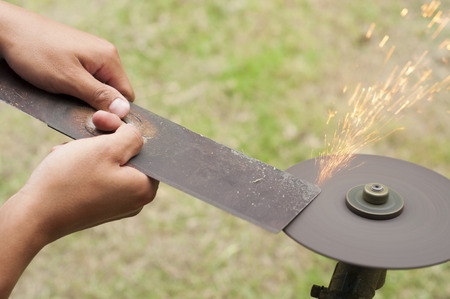 sharpen: Lawn mower blade sharpening  Stock Photo