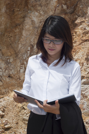 stratigraphy: Beautiful Asian geologist woman researching  Stock Photo