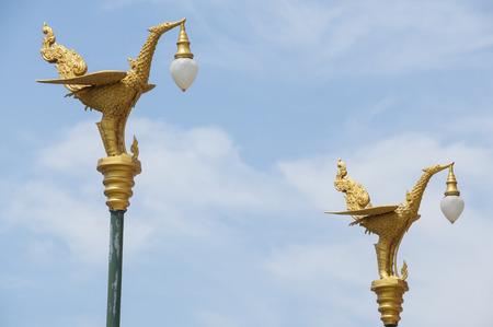Thai art swan on lamp post  photo