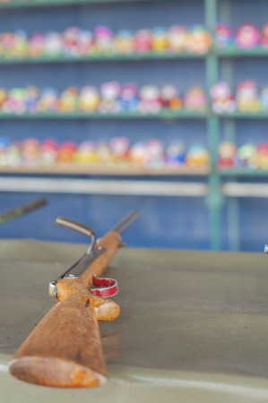 feast: Wooden toy rifle in carnival feast