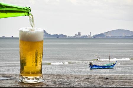 Enjoy beer with sea landscape  photo