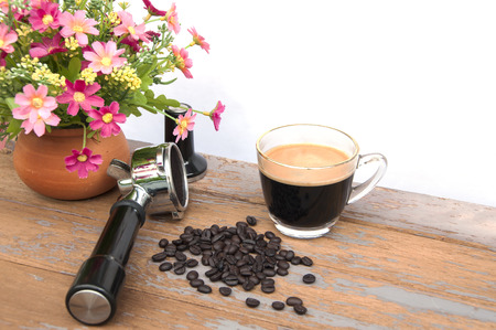 Hot coffee and coffee beans with flower clay pot
