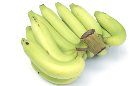 Young green banana isolated. photo