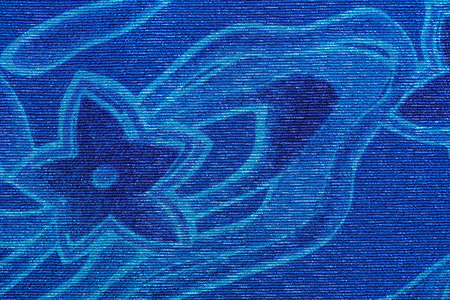 Blue star and wave pattern on fabric.