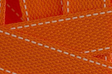Orange strap belt macro closeup as background.