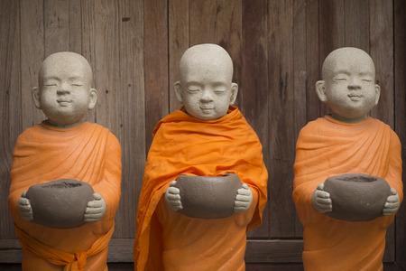 stucco: Little Buddhist monk stucco doll.