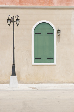 Street lamppost with European window style. Stock Photo