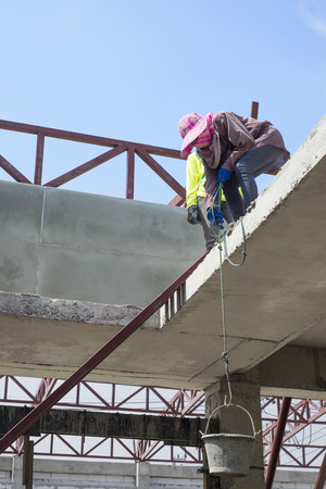 Woman labor worker in construction site.