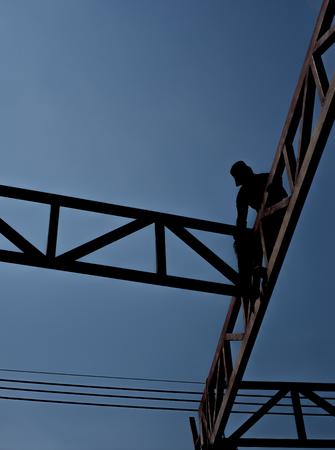Labor worker in construction site silhouette. Stock Photo