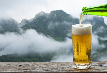 Enjoy beer with mountain landscape.