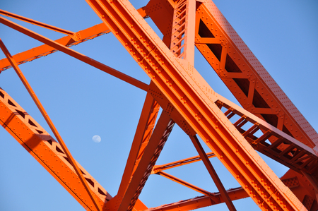 Tokyo Tower and daytime moon, Tokyo landmark with blue sky. Stock Photo