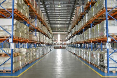 Logistic cargo warehouse with shelves of package on pallet.