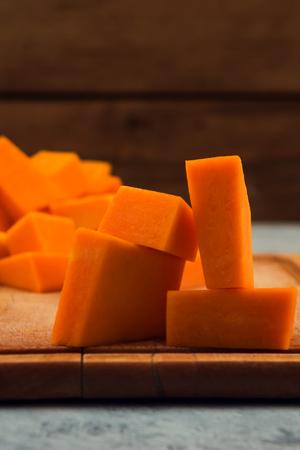 Slices of pumpkin on wooden background. Close up. Raw vegetables. Vegetarian food. Imagens - 113087107