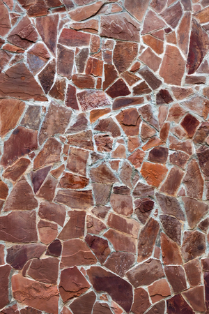 Masonry from the plates. Stone texture. Paved road of slabs. Stockfoto