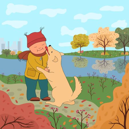 Little boy in warm clothes walking with a dog on the background of the autumn landscape. The dog licks the baby's cheek. Friendship with a pet.