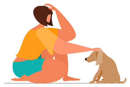 The girl sits and caresses a small dog on the head. Friendship with a pet. Human-animal communication. Vectores
