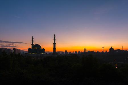 january sunrise: KUALA LUMPUR, MALAYSIA January 10, 2016: The Federal Territory mosque, Kuala Lumpur Malaysia at sunrise