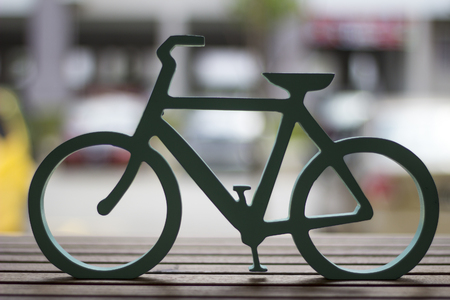 wood carvings: close up bicycle design with wood carvings on the wooden table Stock Photo