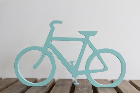 wood carvings: bicycle design with wood carvings on the wooden table Stock Photo