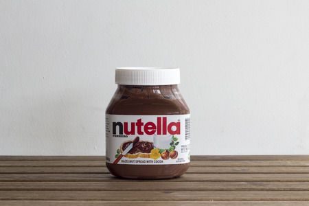 ferrero: KUALA LUMPUR, MALAYSIA - 16012016. Nutella,is the brand name of an Italian sweetened hazelnut chocolate spread.Manufactured by the Italian company Ferrero,it was introduced to the market in 1964. Editorial