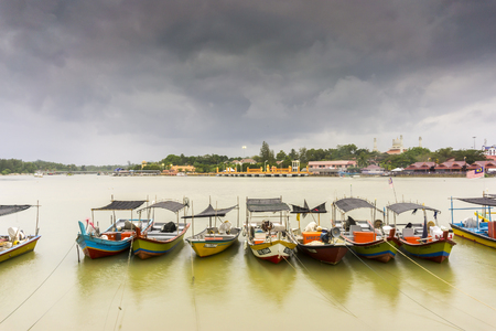 rains: TERENGGANU, MALAYSIA - 09022016 : Fishing boats during cloudy weather before rains Editorial