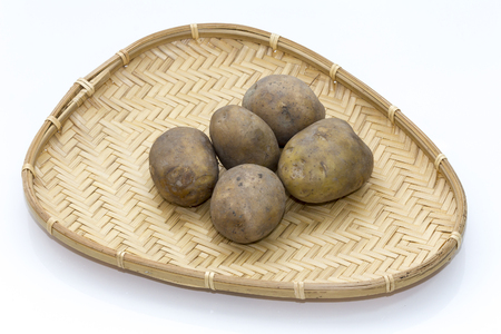 potatoes in a wicker basket Stock Photo