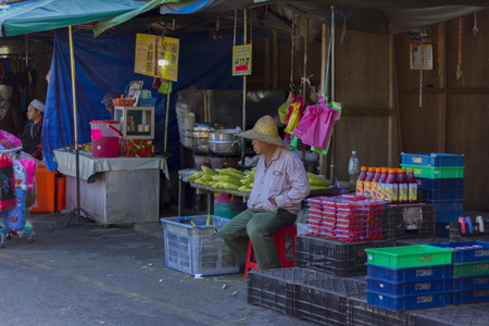 conkers: CAMERON HIGHLANDS PAHANG, MALAYSIA - 06032016: corn sellers are waiting for customers