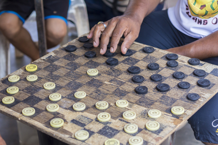 checkers: uncle hands were playing checkers