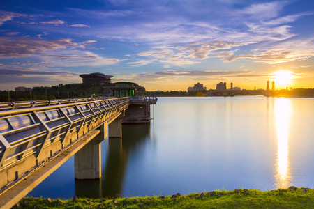 capes: PUTRAJAYA,MALAYSIA - Scenery of main dam in Putrajaya with sunset background Stock Photo
