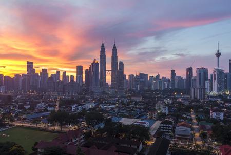 december sunrise: Kuala Lumpur, Malaysia - December 6 2015 : sunrise in the city center and klcc kuala lumpur Editorial